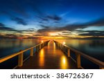 Summer, Travel, Vacation and Holiday concept - Wooden pier between sunset in Phuket, Thailand - stock photo