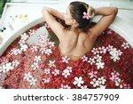 woman relaxing in round outdoor ...   Shutterstock . vector #384757909