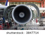 Stock photo opened aircraft engine in the hangar 3847714