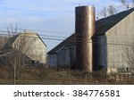 A Pair Of Old Wooden Barns Wit...