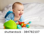 little baby laughs | Shutterstock . vector #384782107