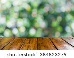 empty wooden table and blurred... | Shutterstock . vector #384823279