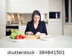 young housewife beginner cook... | Shutterstock . vector #384841501
