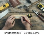 male hands working on carpenter'... | Shutterstock . vector #384886291