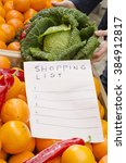 shopping list in grocery store... | Shutterstock . vector #384912817