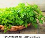 fresh green parsley on wooden... | Shutterstock . vector #384935137