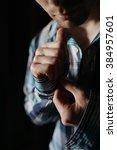 man buttoning his checkered...   Shutterstock . vector #384957601
