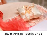 wedding rings on the pillow on... | Shutterstock . vector #385038481