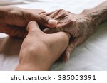 hands of the old man and a... | Shutterstock . vector #385053391