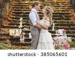 wedding couple in a rustic... | Shutterstock . vector #385065601