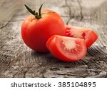 whole red tomato with slice of... | Shutterstock . vector #385104895