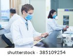 people doing medical experiment ... | Shutterstock . vector #385109254