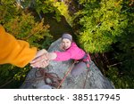 rock climber is helping a young ... | Shutterstock . vector #385117945
