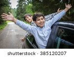happy kids travel by the car | Shutterstock . vector #385120207