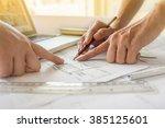 hands of engineer working on... | Shutterstock . vector #385125601