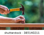 Using hammer and nail on wood...