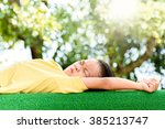 young asian boy lay down on the ... | Shutterstock . vector #385213747
