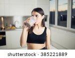 woman in sportswear  drinking... | Shutterstock . vector #385221889