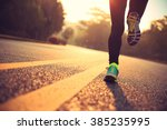 Stock photo young fitness woman runner athlete running at road 385235995
