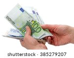 euro and dollars in the hands... | Shutterstock . vector #385279207