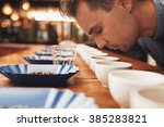 man smelling aromatic coffee at ... | Shutterstock . vector #385283821