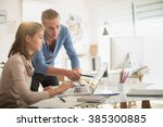 at office  two young creative... | Shutterstock . vector #385300885