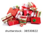 A Pile Of Christmas Gifts In...