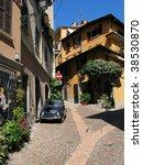 Narrow street of Menaggio town at the lake Como. Italy - stock photo