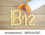 yellow pills forming shape to... | Shutterstock . vector #385316287