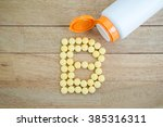 yellow pills forming shape to b ... | Shutterstock . vector #385316311