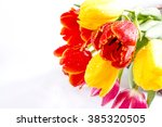 bouquet of tulips on a white... | Shutterstock . vector #385320505
