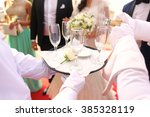 waiter pouring champagne in...   Shutterstock . vector #385328119