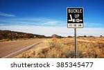 buckle up it's the law sign... | Shutterstock . vector #385345477