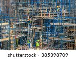 dubai   march 03  builder sits... | Shutterstock . vector #385398709