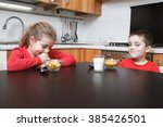 Kids In The Kitchen Eating...