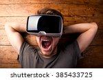 man wearing virtual reality... | Shutterstock . vector #385433725