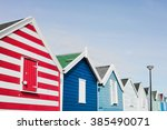 a row of colourful beach huts...