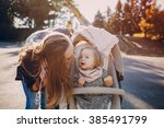 young mother walking with her... | Shutterstock . vector #385491799