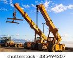 auto cranes on construction site   Shutterstock . vector #385494307