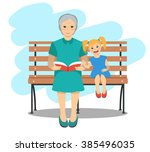 Grandma Sitting On A Bench Wit...