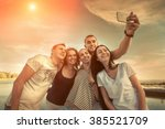 selfie of grop happiness... | Shutterstock . vector #385521709