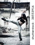 Woman fighter in ruined building. Contrast colors. - stock photo