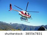 helicopter flying in mountains | Shutterstock . vector #385567831