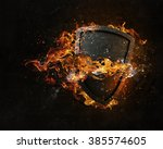 shield burning in fire | Shutterstock . vector #385574605