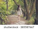 Beautiful Young Woman Walking...