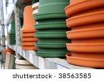 flowerpots on a shelf | Shutterstock . vector #38563585