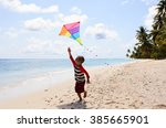 Little Boy Flying A Kite On...