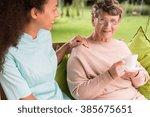 elder lady is drinking tea in... | Shutterstock . vector #385675651
