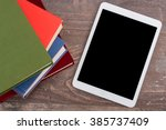 ebook and books  top view | Shutterstock . vector #385737409