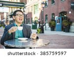 laughing young asian man... | Shutterstock . vector #385759597